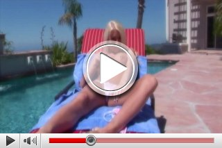 Nadia Hilton enjoys the sun at the pool. Her naked body getting wetter and wetter.